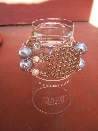 Metal disk and pearl bracelet