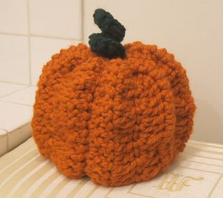 Crocheted pumpkin toilet paper cozy