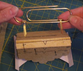 How to attach paper clip handle