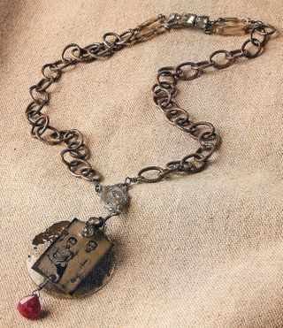 Recycled rosary necklace