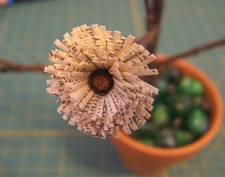 Fringed recycled book flower