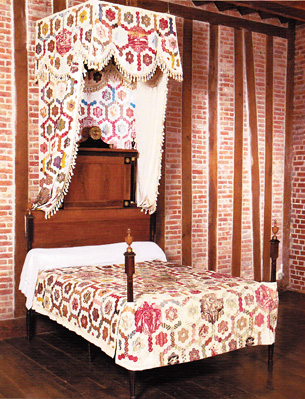 Quilt as a canopy over bed