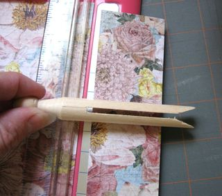 Make a single sheet book with a clothespin